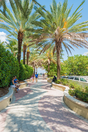 People enjoying the weather and walking along a seaside path in South Beach
