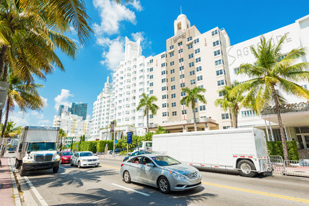 Famous art deco hotels and traffic  at Collins Avenue on a sunny day at Miami Beach