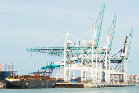 the ocean state: The Port of Miami with containers and cranes on the background