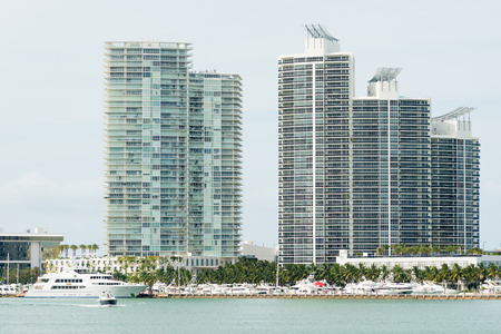 Modern residencial buildings on Miami Beach with modern yachts docked nearby