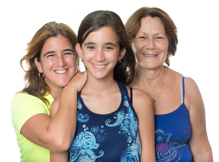 Hispanic girl with her mother and grandmother hugging and smiling isolated on white photo