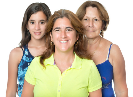 three generations of women: Three generations in a family of hispanic women isolated on white
