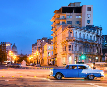 Urban scene at night in Old Havana with a view of the street lamps and the old buildings near El Prado