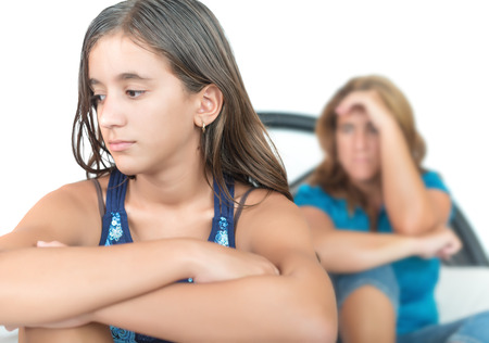 troubled teen: Worried and thoughtful teenage girl with her mother at home