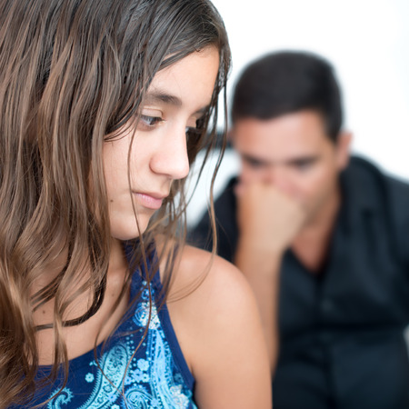 rebellious: Teenage problems, teenage girl and her worried father at home Stock Photo