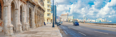 The skyline of Havana with old decaying buildings on the foreground along Malecon avenue Editorial
