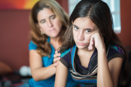 mother and teen daughter: Teenager problems - Mother comforts her troubled teenage daughter