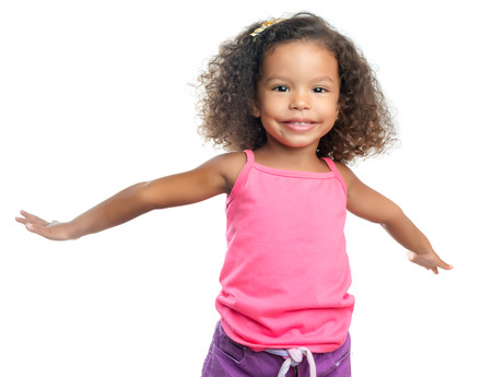 afro caribbean: Joyful little girl with an afro hairstyle laughing with her arms extended isolated on white Stock Photo