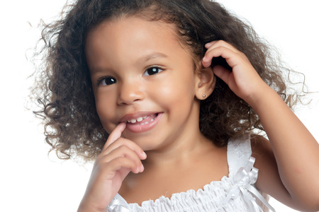 Close up portrait of a little girl with an afro hairstyle Stock Photo
