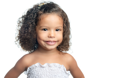 latin american ethnicity: Portrait of a small afro american girl with curly hair isolated on white Stock Photo
