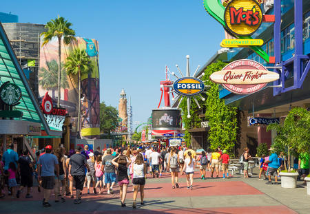 A crowd of visitors walking towards the entrance of the Universal Orlando Resort theme parks