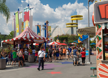 themed: People at a Simpsons themed area at the  Universal Studios Florida theme park