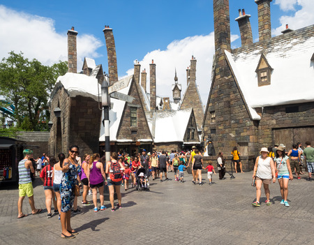 theme parks: Visitors enjoying the Harry Potter themed attractions and shops at the  Hogsmeade Village inside Universal Studios Islands of Adventure theme park Editorial