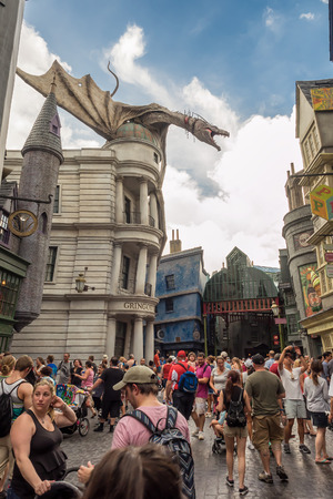 harry: Crowds and dragon at Diagon Alley near the Harry Potter ride at Universal Studios Florida theme park Editorial