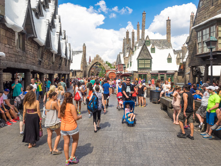 Visitors enjoying the Harry Potter themed attractions and shops at the  Hogsmeade Village inside Universal Studios Islands of Adventure theme park Redakční