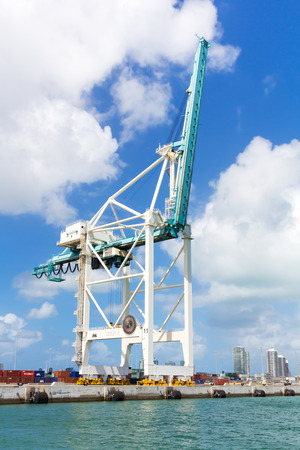 manipulate: Modern crane used to manipulate cargo at the Port of Miami Editorial