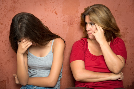 mother and teen daughter: Teenager problems - Sad crying teenage girl and her worried mother