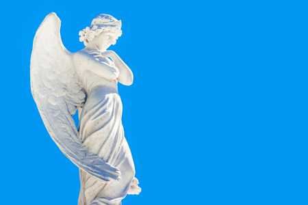christianism: Beautiful angel with a clear blue sky background with space for text Stock Photo