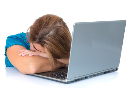tired woman: Tired woman sleeping over her laptop computer isolated on white Stock Photo