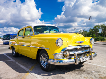 Colorful yellow vintage car in Havana Publikacyjne
