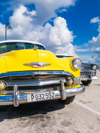 yellow car: Colorful yellow vintage car in Havana Editorial