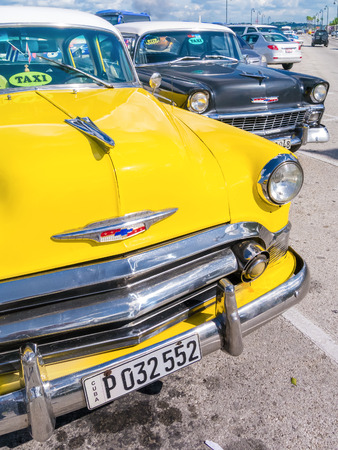 chevrolet: Colorful yellow vintage car in Havana Editorial