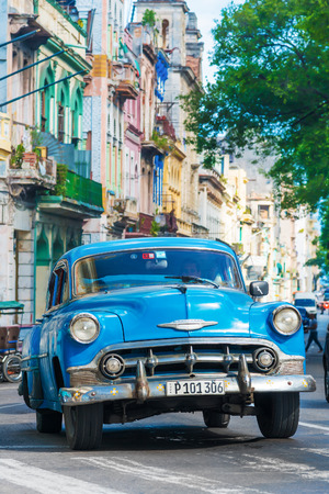 chevrolet: Old classic cars used a taxis circulating on a well known street in Havana
