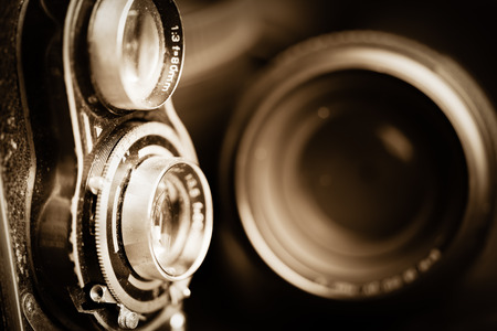 Vintage camera and lenses toned in sepia photo