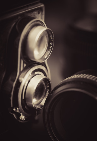 Vintage camera and lenses toned in sepia Фото со стока - 33527650