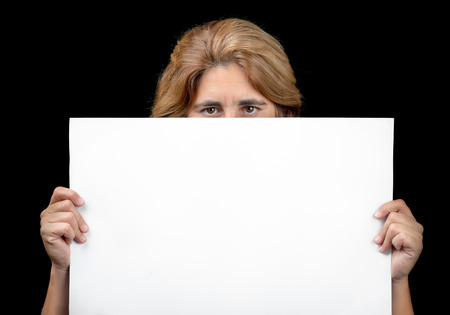 holding blank sign: Woman hiding behind a white banner with space for text (isolated on black)