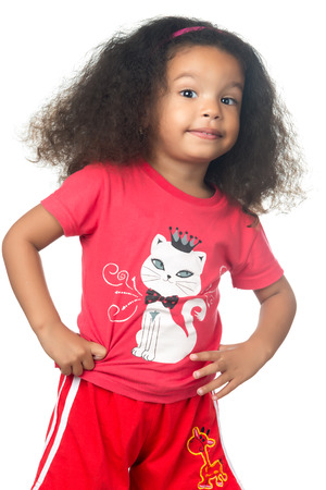 afro caribbean: Cute and funny small afroamerican girl wearing colorful clothes isolated on white Stock Photo