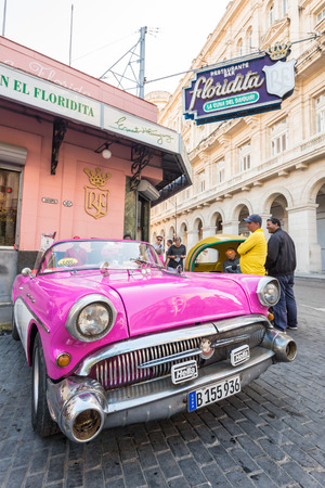 Old american car next to the famous Floridita restaurant in Old Havana Editorial