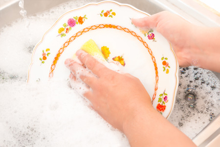 house chores: House chores - Washing the dishes on the kitchen sink