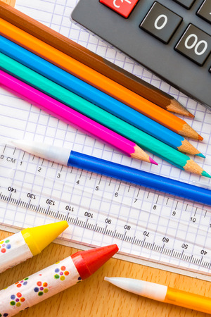 implement: School and art supplies on a wood background Stock Photo