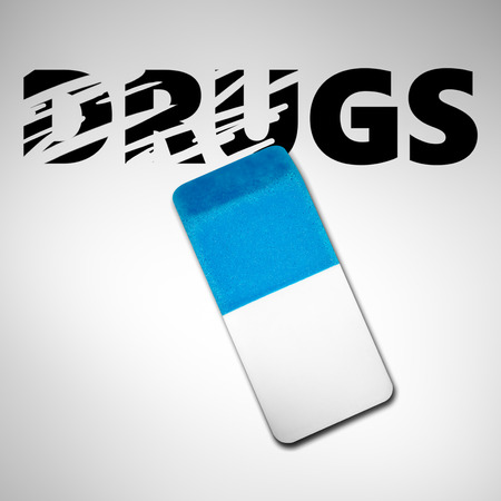 substance abuse: Eraser erasing the word DRUGS on a white background