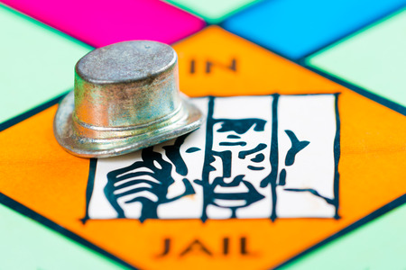 token: Hat token next to the JAIL space in a game board Stock Photo