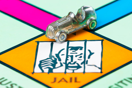 token: Car token next to the JAIL space in a game board