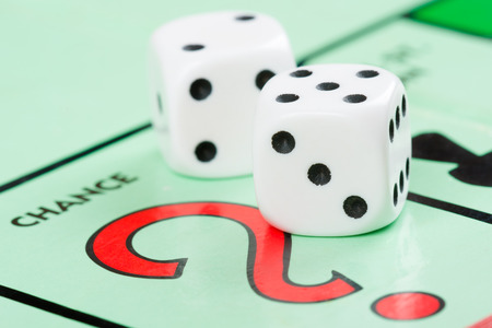 a pair: Pair of dice next to the CHANCE card drawing space in a  game board