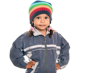 mixed race ethnicity: Mixed race little girl wearing a colorful beanie hat and a jacket isolated on white