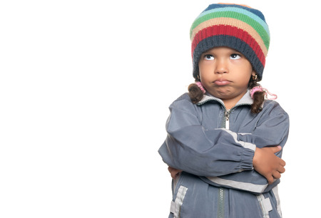 disobedient child: Angry little multiracial girl isolated on a white background