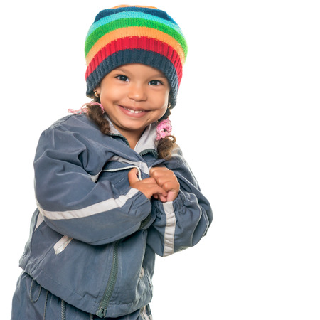 beanie: Funny mixed race little girl wearing a colorful beanie hat and a jacket isolated on white