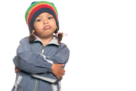 disobedient child: Little multiracial girl with a funny hip hop artist attitude isolated on white