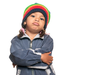 Little multiracial girl with a funny hip hop artist attitude isolated on white photo
