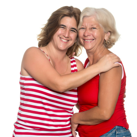 Adult hispanic woman hugging her mother isolated on white photo