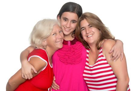 three generations of women: Happy family of three generations of hispanic women isolated on white Stock Photo
