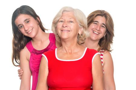 three generations of women: Three generations of hispanic women smiling isolated on white