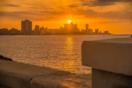 seawall: Beautiful colorful sunset in Havana with a view of the Malecon seawall and the city skyline
