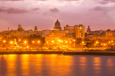 capitolio: Sunset in Havana with a view of the Capitol and illuminated street lamps Stock Photo