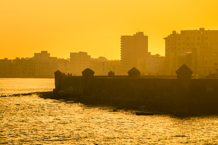 seawall: Colorful sunrise in Havana with a view of the malecon seawall and the city skyline