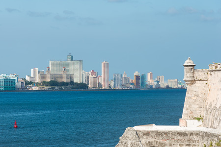 The skyline of Havana with a tower from a colonial fortress on the foreground